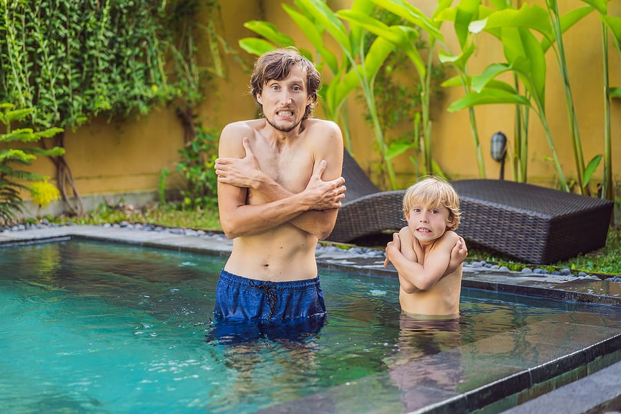 Father and son cold in pool because they need a pool heater
